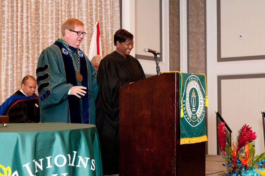 Dr. Roger H. Sublett welcomes La June Montgomery Tabron, president and CEO of the W.K. Kellogg Foundation, to the podium as the Florida Commencement speaker.