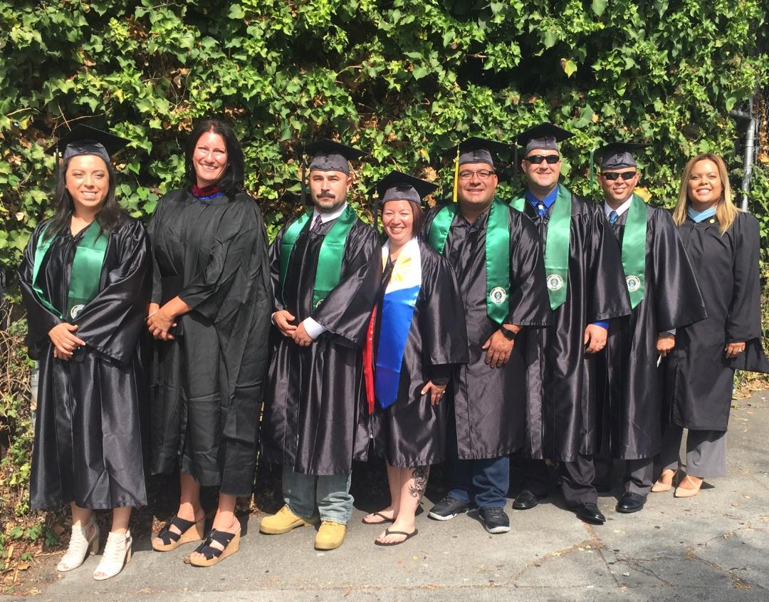 California graduates pose after the commencement ceremony